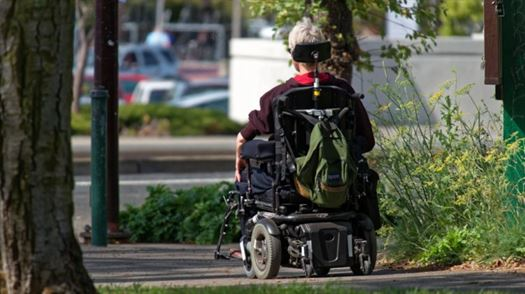 motorized_wheelchair_wheelchair_elderly_man_motorized_backpack_sunny_day_pavement-858187